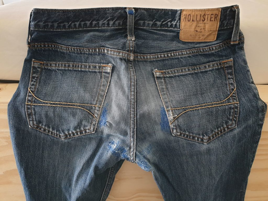 Jeans with darned repair
